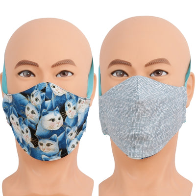 This reversible face masks has a pretty blue cat fabric on one side and a neutral blue print on the other. Triple layer cotton fabric facemask has a filter pocket, nose wire. Mask has different wearing options including behind the head band that doesn't use your ears, a ribbon lanyard head strap, and adjustable ear loops. Washable, reusable and ​made in USA