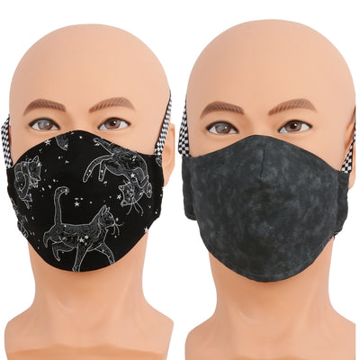 Reversible face mask in black constellation cats fabric. Triple layer cotton fabric mask with filter pocket and nose wire. Adjustable behind the head band to keep the pressure off of your ears, or adjustable ear loops. Made in USA.