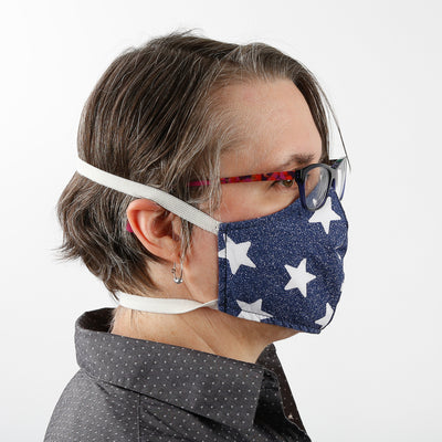 Contour style face mask with two wide bands of elastic that go behind the head, this style fits tight on the face and stays in place, a secure fitting face mask when you're active or if you wear glasses.