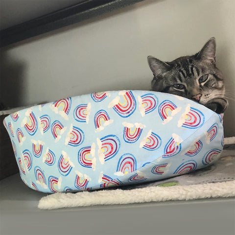 Cat Canoe® modern cat bed in a blue pastel rainbow print