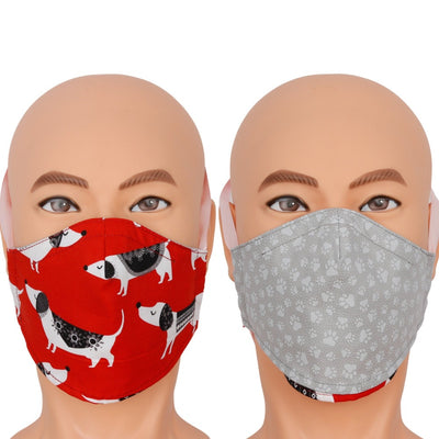 Reversible face mask in a cute novelty fabric with Dachshund dogs wearing swearers. This red face mask flips over to a dog paw print in grey. Triple layer cotton fabric mask with filter pocket and nose wire. Adjustable behind the head band to keep the pressure off of your ears, or adjustable ear loops. Made in USA.