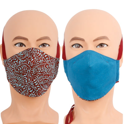 Reversible face mask in a red and turquoise blue floral print, the reverse is solid turquoise. Triple layer cotton fabric mask with filter pocket and nose wire. Adjustable behind the head band to keep the pressure off of your ears, or adjustable ear loops. Made in USA.