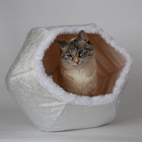 The beautiful winter white Cat Ball cat bed is made in velvet and fur, and is a perfect Christmas present for your cat