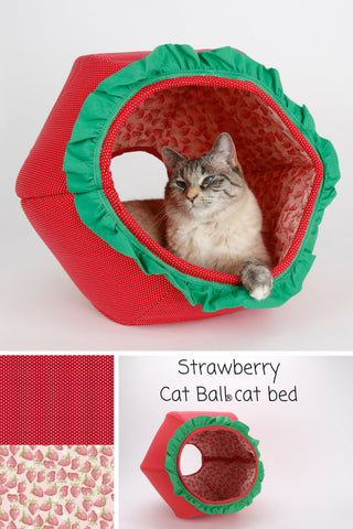 This novelty Cat Ball® cat bed looks like a strawberry. Our cute fruit pet bed is a perfect place to take funny cat photos, and is a cotton fabric cat cave,  Our hexagonal Cat Ball® cat bed has two openings and is made in the USA.