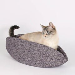 This Cat Canoe made in a purple paisley fabric to create a Victorian look cat bed