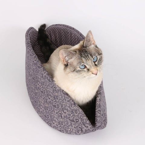 The purple paisley Cat Canoe is a Gothic cat bed