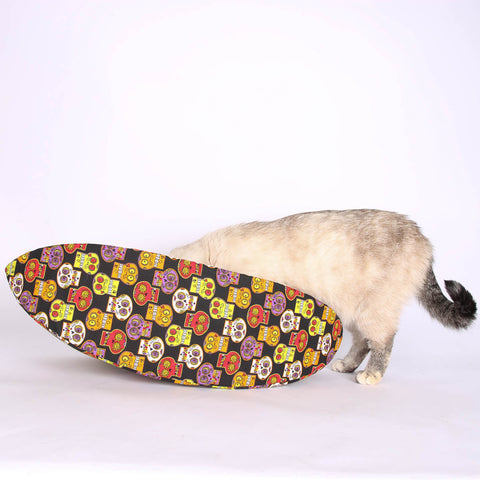 The Cat Canoe pet bed made with sugar skulls fabric