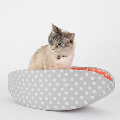 The Cat Canoe is a modern cat bed, made in grey and coral polka dot cotton fabrics. This designer pet bed is made in the USA