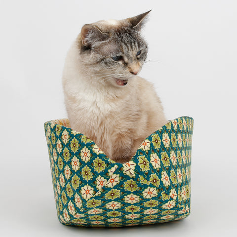 Cat Canoe pet bed made in a green flower tile fabric
