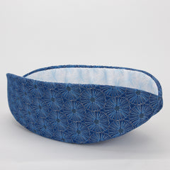 Cat Canoe,  a  modern cat bed shaped like a boat, made in blue and silver floral print
