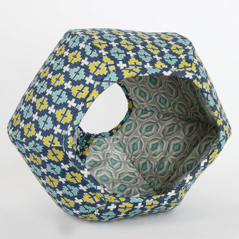 The Cat Ball is a cozy pet bed in a hexagonal design and had two openings