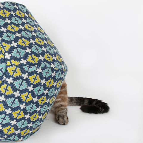 Cat Ball cozy pet bed in a navy, turquoise, and chartreuse geometric pattern