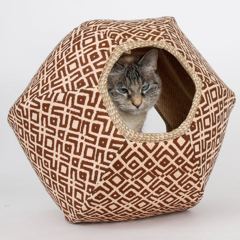 This Cat Ball®cat bed is in a tan and brown fabric with a tribal print.