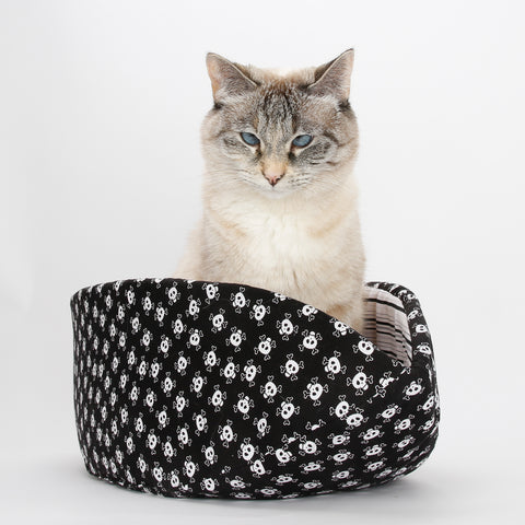 Cat Canoe in skull and crossbones fabric, a modern cat bed made in USA