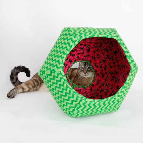 The green zig zag watermelon Cat Ball pet bed is lined with a funny black cat fabric