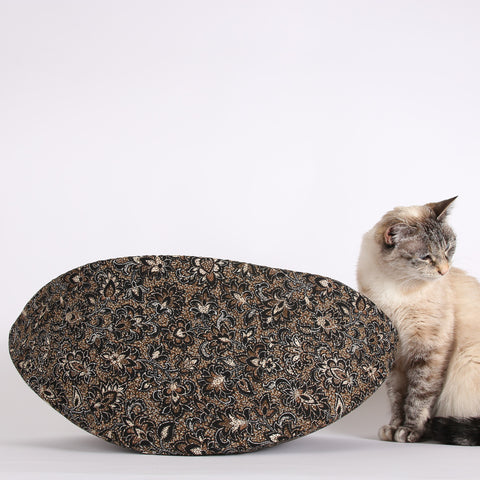 The jumbo Cat Canoe is a modern cat bed, made in the USA with brown batik cotton fabric