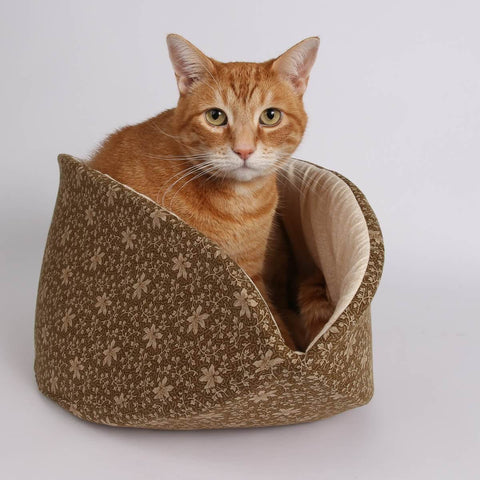 Orange ginger tabby cat inside a jumbo CAT CANOE cat bed