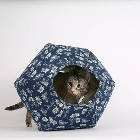 The CAT BALL is a modern, cave style, covered cat bed. Our original, hexagonal, designer pet furniture has two openings, for warm, hidden naps in a cute bed