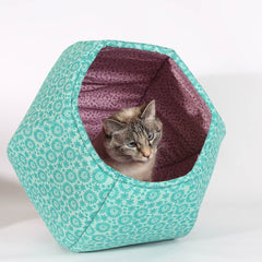 The Cat Ball is a modern cat bed, made here in teal and purple cotton fabrics