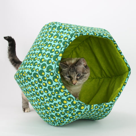 This Cat Ball cat bed made in a mod print in shades of green with a lime lining. Our original, hexagonal, pet bed design has two openings and is made in USA