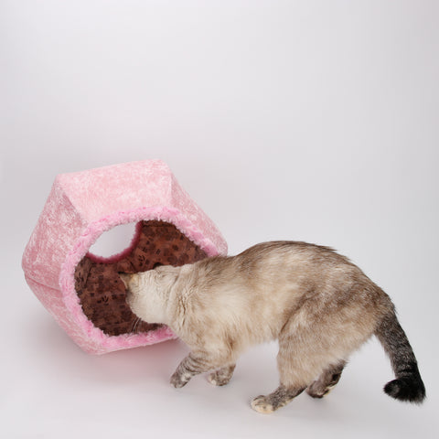 The Cat Ball is a modern cat bed, made here in baby pink velvet, with soft fur trimmed openings and lined with a grey cat print fabric in cotton. This pod style cat bed is made in the USA.
