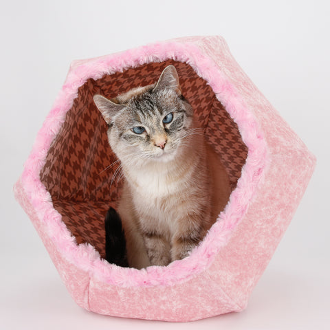 The Cat Ball is a modern cat bed, made in baby pink velvet, with fur trimmed openings and lined with a grey and white cotton  houndstooth fabric. This pod style cat bed is made in the USA.