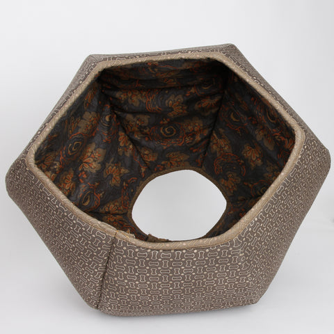 The Cat Ball is a hexagonal cat bed with two openings. This pod style modern cat bed was made in the USA