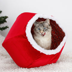 The Christmas Cat Ball® cat bed gives your kitty an excuse to nap under the Christmas tree! This cute Santa cat bed is made in USA with red velvet and white fur