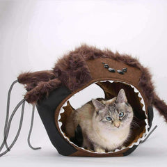 The CAT BALL is a hexagonal cat bed with two openings. The spider Cat Ball® is a spooky, novelty, Halloween themed, cat bed made in the USA by The Cat Ball, LLC