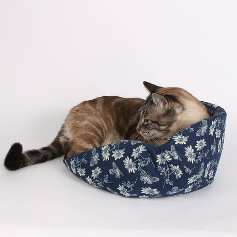 The CAT CANOE in a navy blue butterfly fabric from the Riley Blake Meadow fabric collection
