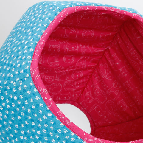 The Cat Ball pod style cat bed in capri blue and deep pink paw print fabric