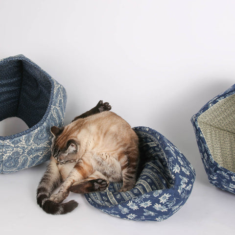 The CAT CANOE in a navy blue butterfly fabric and coordinating CAT BALL cat beds