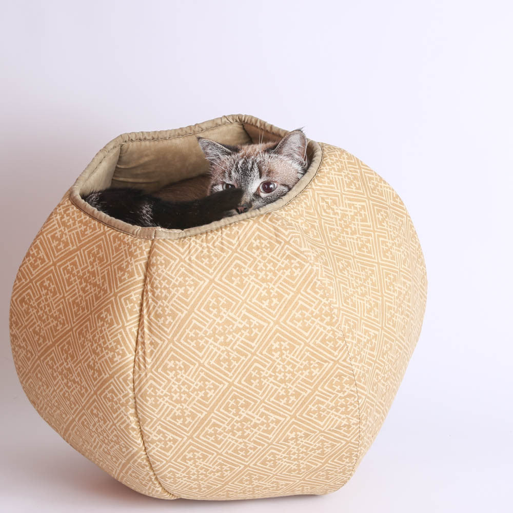 the cat ball® modern cat bed in neutral ecru celtic knot  the cat  - our original · the cat ball is a modern cat bed in a hexagonal shape withtwo openings