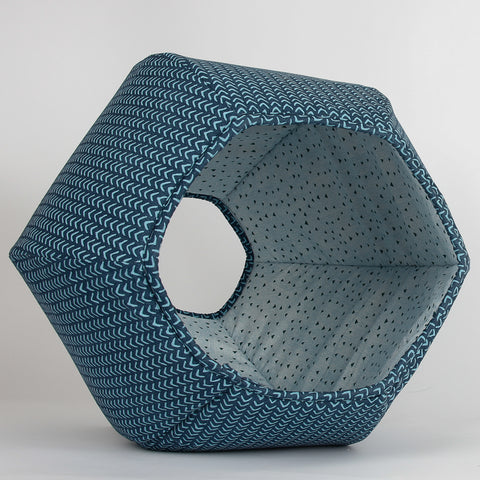 The Cat Ball® cat bed is a modern cat bed with two openings, one larger than the other. Made in USA in teal geometric cotton fabrics