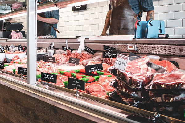 Butcher counter with beef cuts.