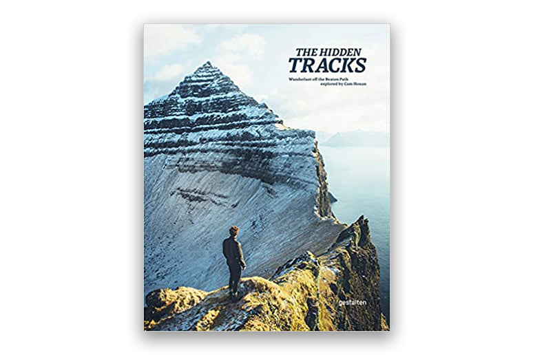 Hiking coffee table book on white background.