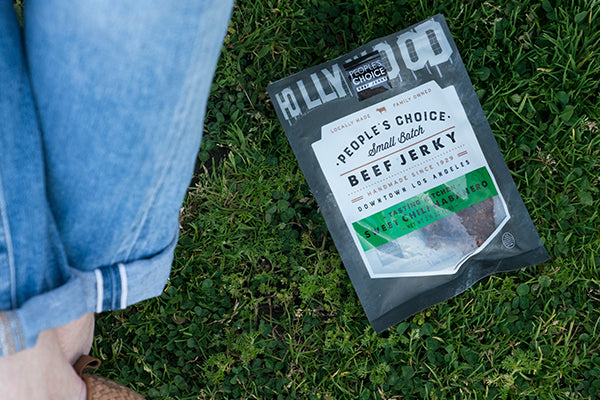Jerky on grass with jeans and shoes