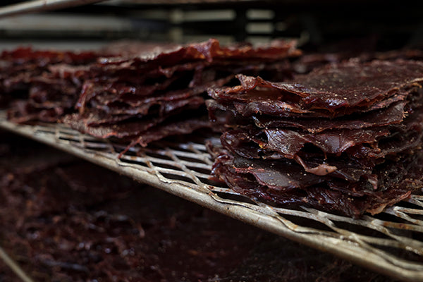 Beef Jerky on a Rack Stacked Up