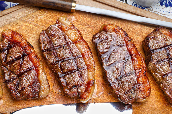 Cooked picanha steaks on a cutting board