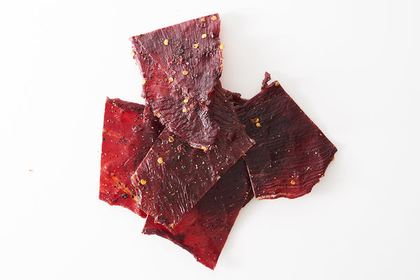 Classic Beef Jerky on white background.