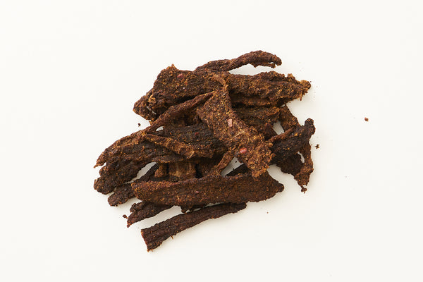 Hatch Green Chile Beef Jerky on white background.