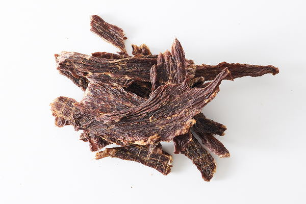 Old Fashioned beef jerky on white background.