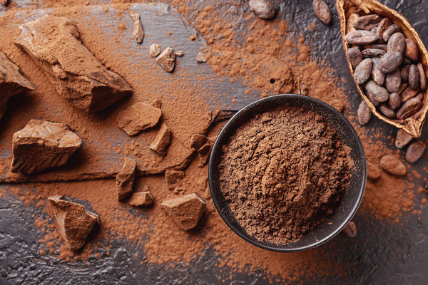 Cacao in various forms on a black background
