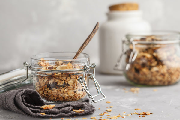 Granola in glass jars on clean background