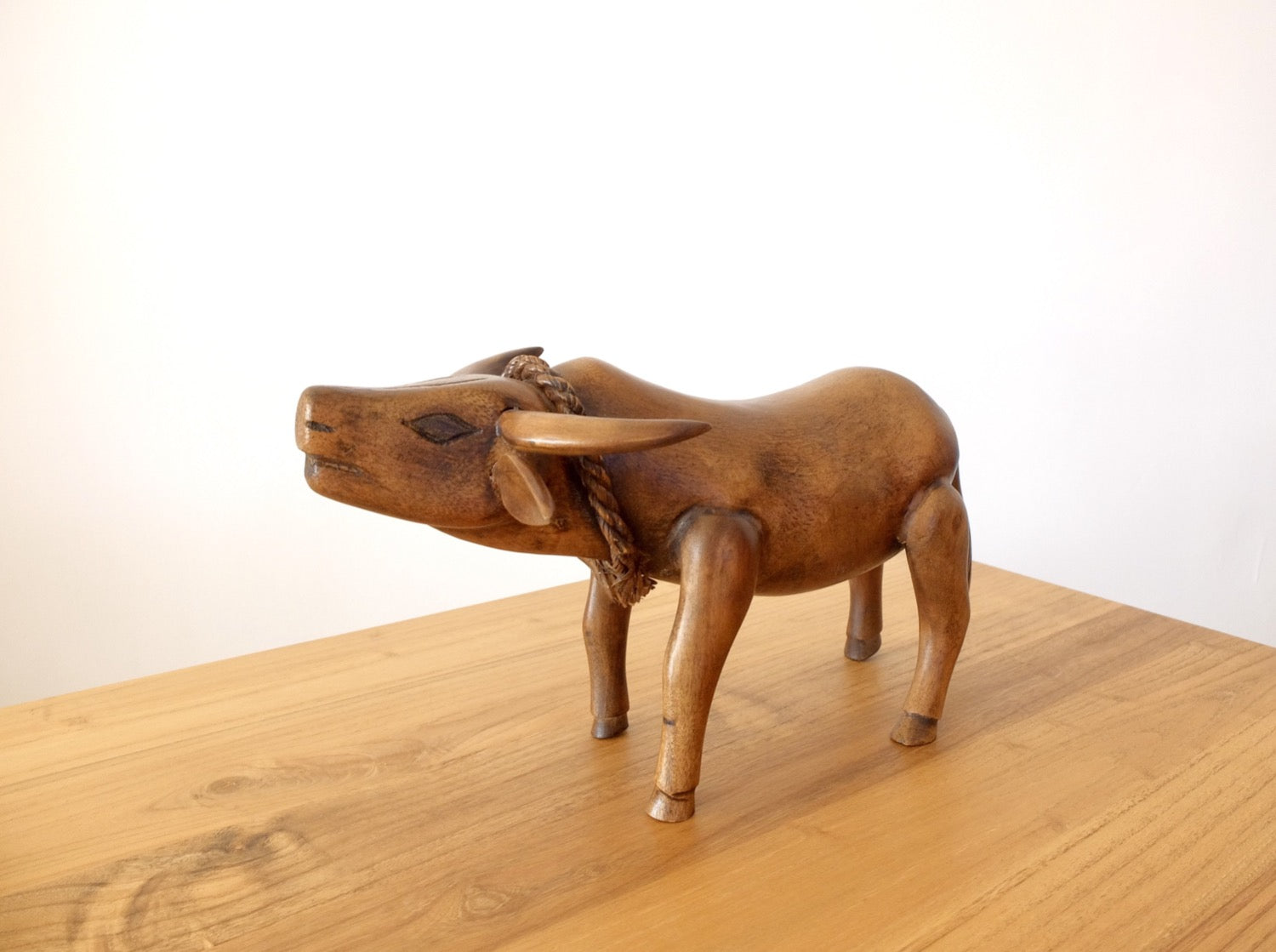 Buffalo figurine carved in teak wood, in natural brown colour