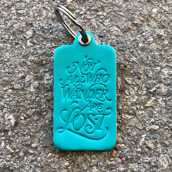 """NOT ALL WHO WANDER ARE LOST"" KEY TAG"