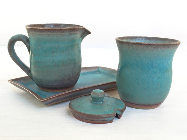 cream and sugar set, blue creamer and sugar bowl, shown with top off
