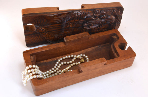 puzzle box | hand carved dragon, fair trade from Bali, shown open holding jewelry