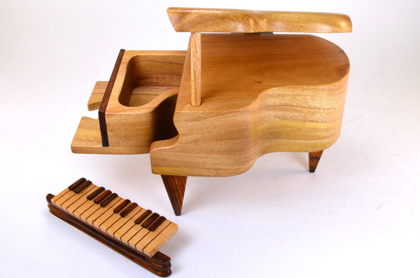 puzzle box | handcrafted, wooden piano box, puzzle pieces shown