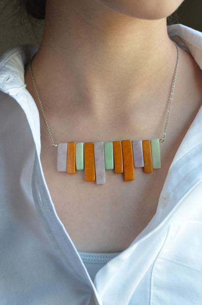 Tagua Nut Piano Necklace Orange Purple Green on Model